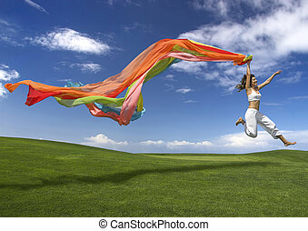Rainbow woman - Young beautiful woman jumping with a scarf