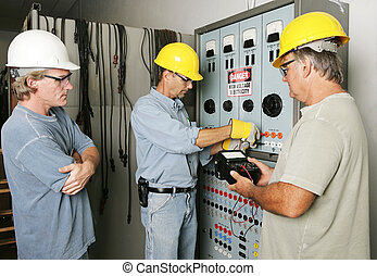 Electrical Team at Work - Electricians working on an...