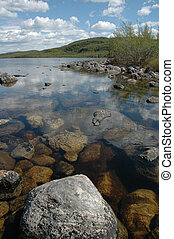 Northern Lake Shoreline - A Rocky shoreline on a Northern...