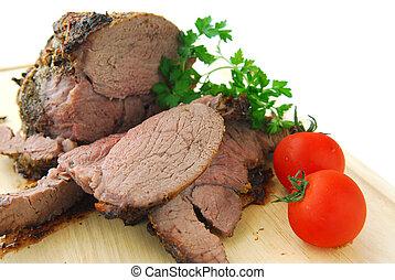Beef roast cut on a cutting board