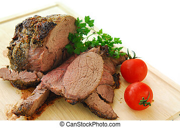 Beef roast cut on a wooden cutting board