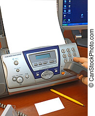 fax and business paper - The person works on a fax to the...