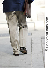 Businessman walking on a busy street downtown