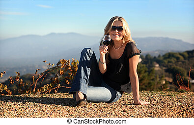 Blond woman with a glass of wine - Blond woman enjoying wine...