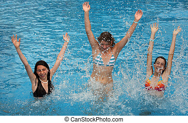 Girls in the pool - Three young girl jumps in the pool