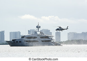 helicopter and yacht - helicopter about to land on back of...