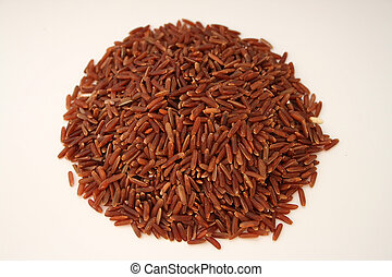 Brown rice - Pile of brown rice isoleted on white