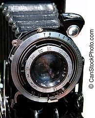 A Vintage Camera - A vintage camera against a bright...