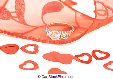 engagement ring - sparkling engagement ring on red ribbon...