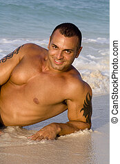 Tanned Male Model Lying Down on Beach