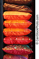 Pillows - Stack of colorful satin pillows.