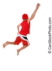 Jump for Joy - Boy jumps hand raised in the air Jump for...