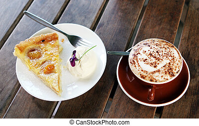Pie and coffee - Apricot pie and cream with a cafe latte