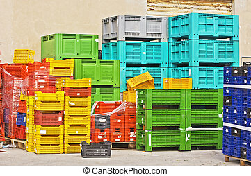 Coloured crates - Coloured stacks of fruits and vegetable...