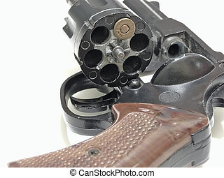 Russian roulette - open cylinder of revolver with one bullet...