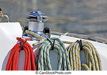 Coloured ropes - Three coloured ropes wrapped and tied on a...