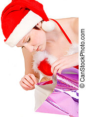 Christmas faerie unwrapping a present - Beautiful girl...