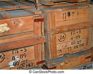 Lumber - The image of old wooden boxes with gas masks in a...