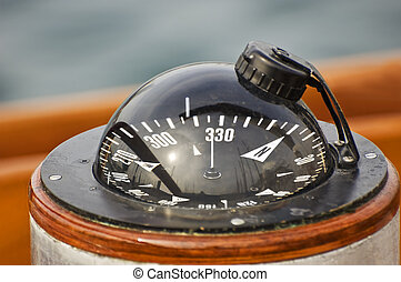 Boat compass - A big compass on a boat showing direction