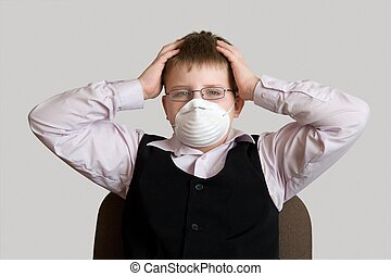 Ecological threat The little boy in a respirator