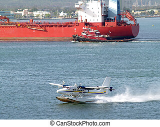 Port traffic in San Juan - Airplane and tanker a port in San...