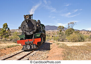 old steam train - an old steam train goes through the...
