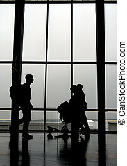 Travellers at an airport, walking to next gate