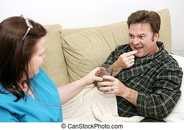 Home Health - Pills - Patient taking medication from his...