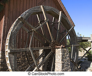 Mill Wheel with Lights - An old water wheel on a mill with...