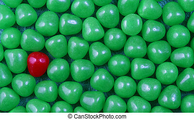 Christmas candy - A single red candy and a cluster of green...