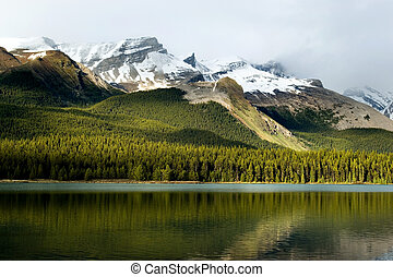 Canadian Rockies - Rockies mountain range reflecting in...