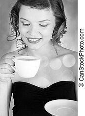 girl with a cup of coffee - glamorous girl having a cup of...