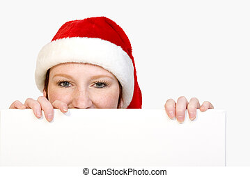 Christmas girl holding up a white sign for copyspace -...