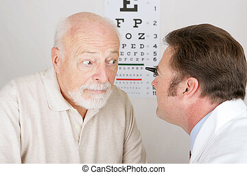 Optical Series - Eye Exam - Optician using and...
