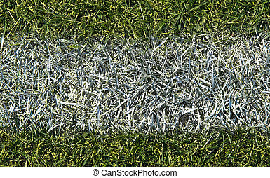 Playing field background - Closeup of white boundary line of...