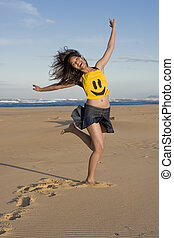 Happy Face - Girl with happy Face top running at the beach