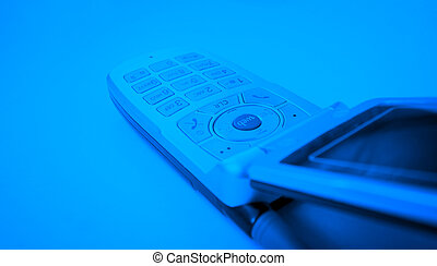 Cell phone isolated on blue