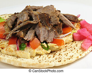 Shawarma Beef With H - Shawarma style beef on a pita, with...
