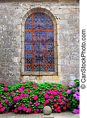 Church window in Brittany - Stained glass church window on...