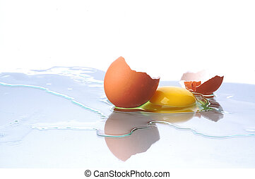 one egg was broke on glass table isolated on white...