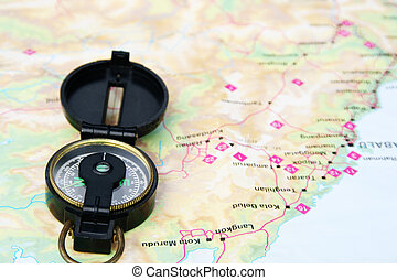 Compass - A navigational compass laid on a map