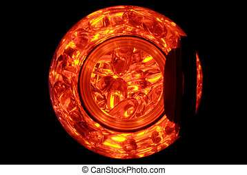 Red Capsules in a Jar - The circle of a jar with backlit red...