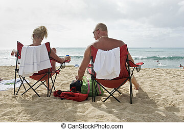 Couple on the Beach, Waikiki - Couple sitting in folding...