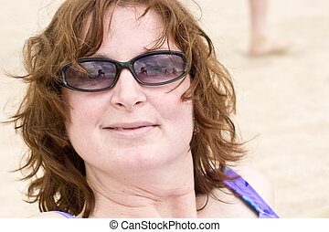Woman in Sunglasses on the Beach - Photo of an attractive,...