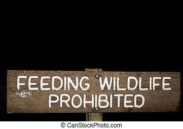 Feeding wildlife roadsign - A roadsign instructing people...