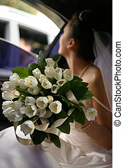 Wedding bouquet - The bride looks in a window of the...
