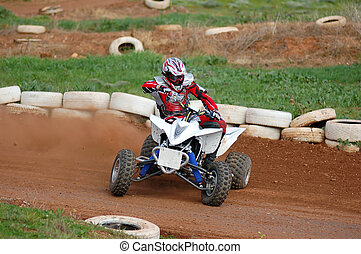 Quad Bike Racing - Quad bike racing, sideways around a...