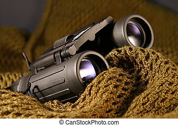 Military spyglass closeup - A military black spyglass laid...