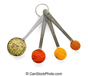 Spices in measuring spoons - Assorted spices in measuring...