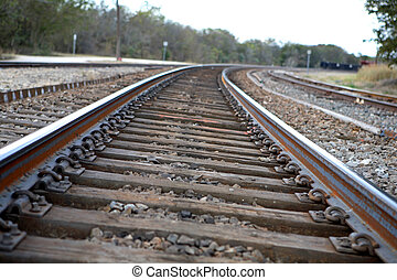 Railroad Tracks - Set of railroad tracks leading into the...